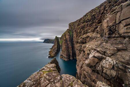 Spectacular long exposures of steep coast of Faroe Islands