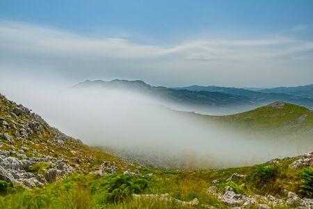 Ultra long exposure of mist over the mountain Фото со стока
