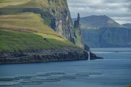 Faroe Islands, Sandavagur long shot with fish farms, Witchs Finger
