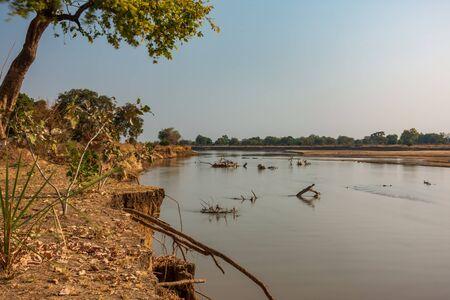 Ultra long exposure of luangwa river with trunk debris Stock fotó