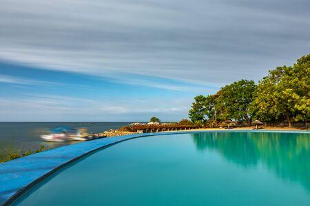 Spectacular swimming pool and marina long exposure