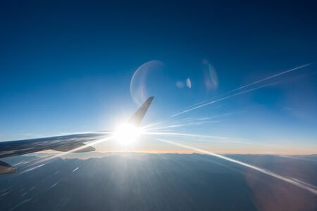 Light beams in jet airplane wing flying Stok Fotoğraf