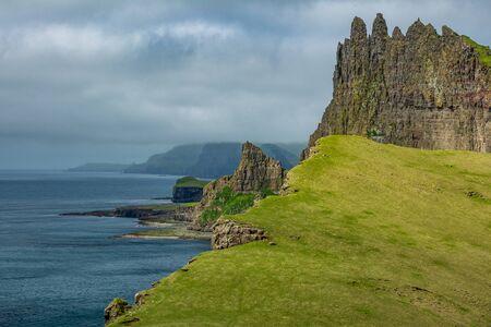 Amazing profile view of Tindholmur and coast, Faroe Islands