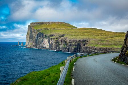 Road and The Giant and the Wich in northern coast of Eysturoy in Faroe Islands.