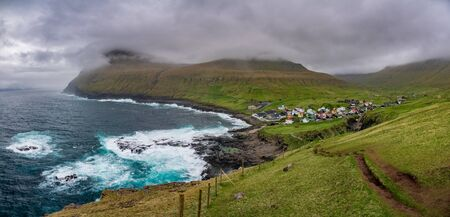 Gjogv gorge and town on the island of Eysturoy in the Faroe Islands. Panoramic view