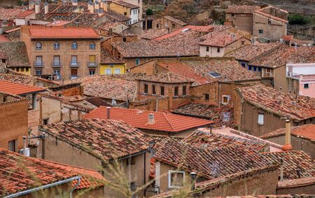 Detailed view of antique tile roofs and houses