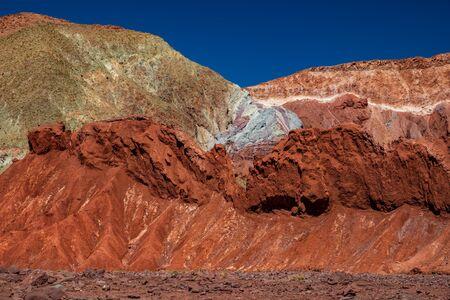 Rainbow valley with bright colors under blue sky in Atacama