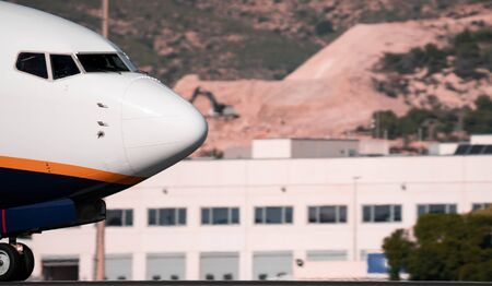 Jet plane snout landing in the runway