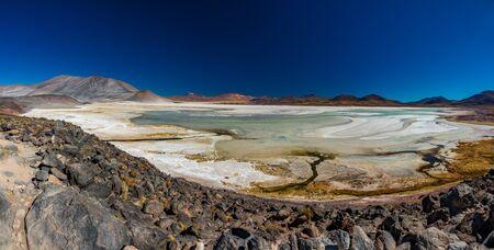 Red stones and Talar salar panorama in Atacama