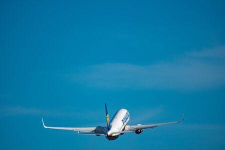 Ryanair plane taking off at dusk