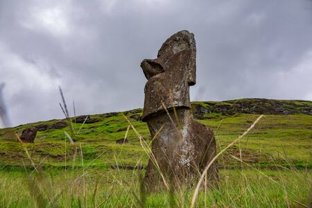 Bottom view of single moai under cloudy sky