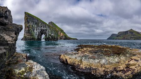 Gigapan panorama bottom view of the amazing Drangarnir gate in front of Tindholmur, Faroe Islands, Denmark. Imagens