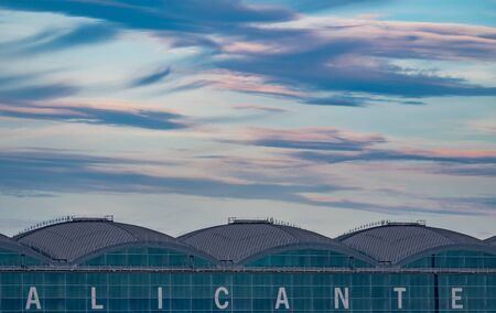 Top of Alicante airport terminal at sunset with cloudy sky and text space Imagens