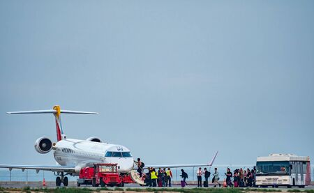 Iberia plane and bus with people entering the jet Editorial