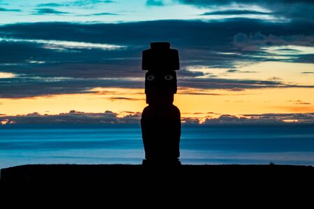 Sunset over Easter Island with Moai silhouette and silk water