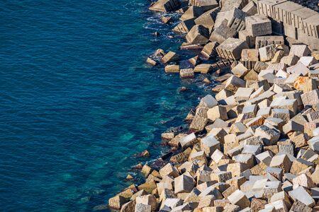 Huge concrete cubes near the ocean, top view