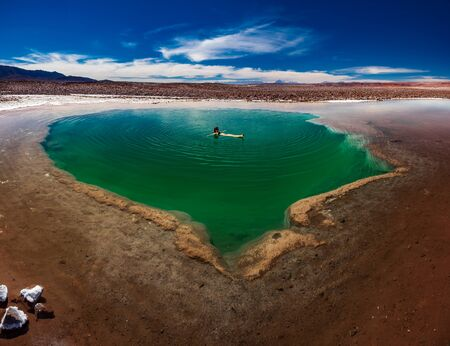 Spectacular Baltinache lagoon with tourist woman floating