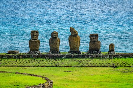 Moai platform with several statues in different conservation
