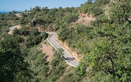Top view of mountain road with curves