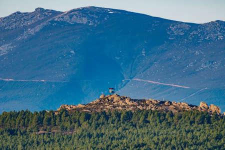 Fire watching hut on top of the mountain Фото со стока