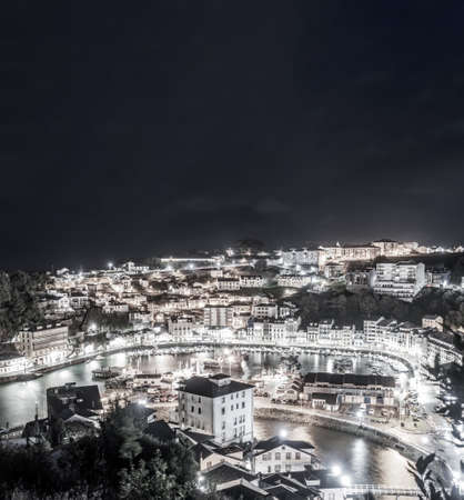 Luarca city by night, top view long exposure