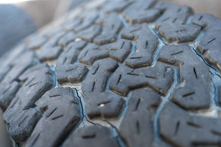 Run-down 4x4 tire closeup view with shallow depth of field