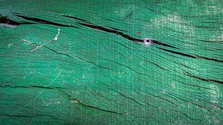 Spiderweb hole over the green wooden door
