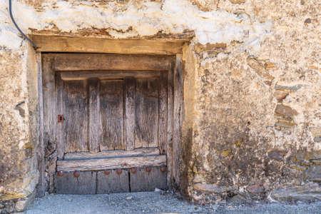 Old antique wooden door under the street level