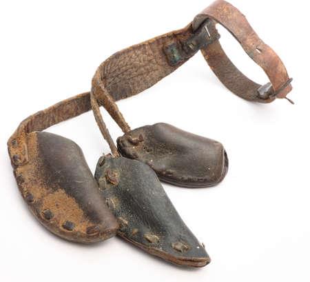 Old leather finger protectors for sharp scythe Imagens