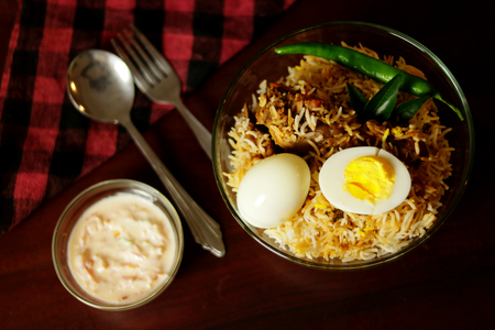 Delicious chicken biriyani on top with water class