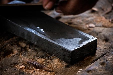 Carpenter blade sharpener black stone 免版税图像