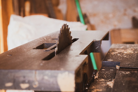 circular saw with carpenter store blur background