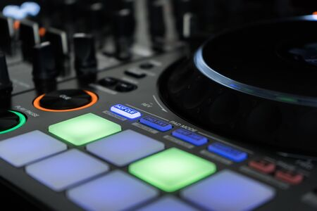 Close up DJ mixer player and sound console for house music party 写真素材