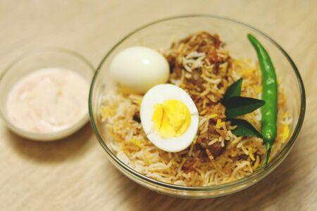 Delicious chicken biriyani wood background Stock Photo - 130926417