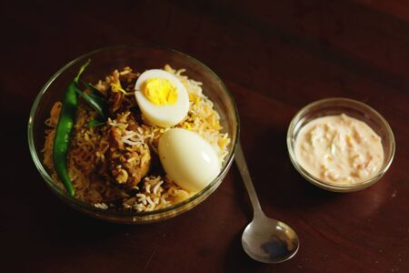 Delicious chicken biriyani with spoon