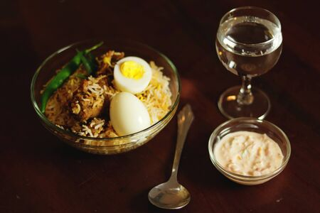Delicious chicken biriyani spoon with water class