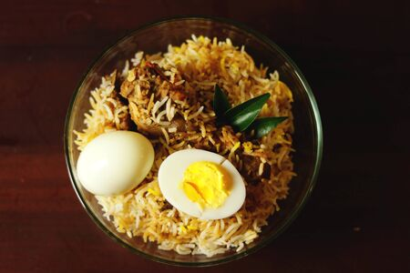 Delicious chicken biriyani on table top view