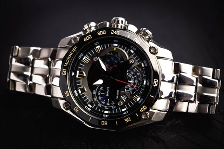 close up view of nice mans wrist watch on black background