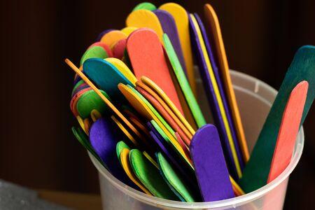 rainbow color sticks on cup Stok Fotoğraf