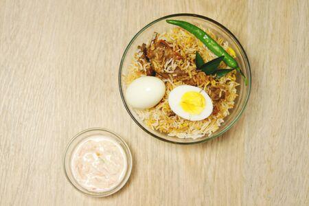 Delicious chicken biriyani wood background