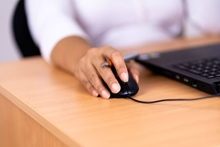 Female hand holding computer mouse Stok Fotoğraf