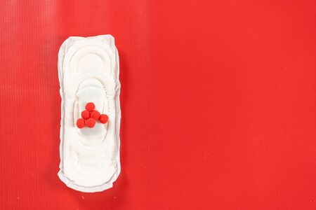 close up of woman hygiene protection on red background