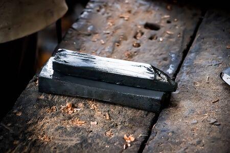 Carpenter blade sharpener black stone 스톡 콘텐츠