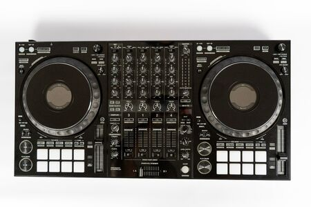 Black modern audio controller and professional headphones. Set of DJ instrument. Top view