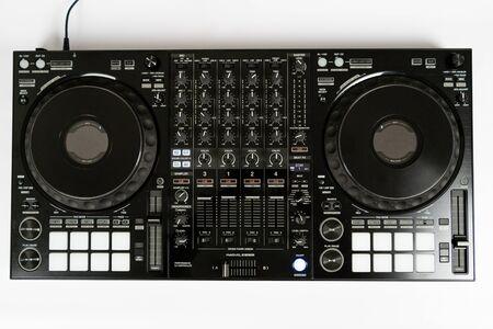 Black modern audio controller and professional headphones. Set of DJ instrument. Top view
