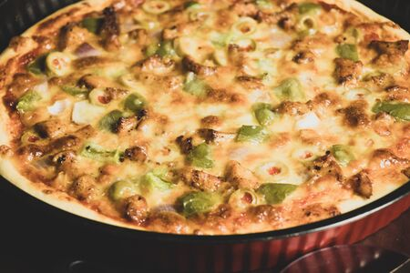 Pan Pizza take from very closeup and red pan