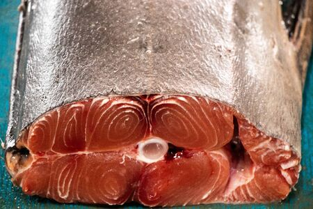 big raw fish slice on table in fish market closeup