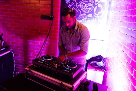 Male DJ playing music in club 写真素材