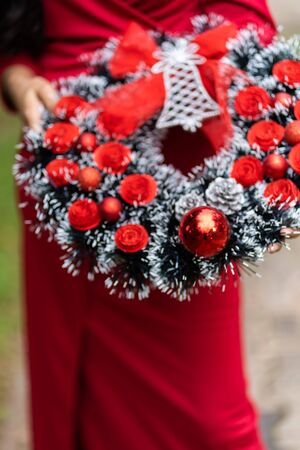 Advent Christmas wreath hold on young lady