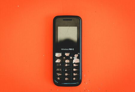 Old black feature phone showing its number keypad